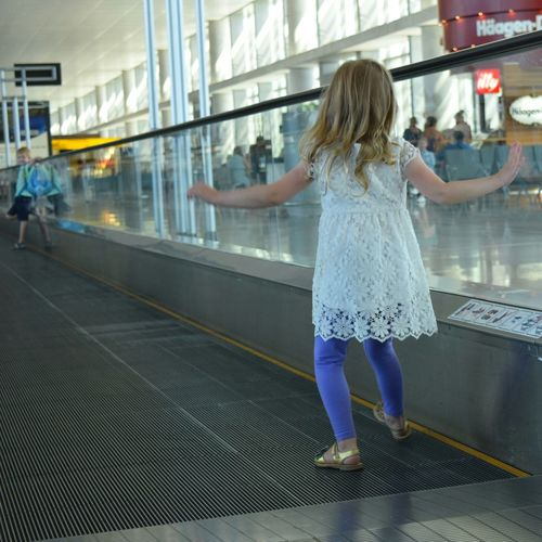 Airport Sliding Scale Boy And Girl Playing Barcelona On The Way An Eye For Travel
