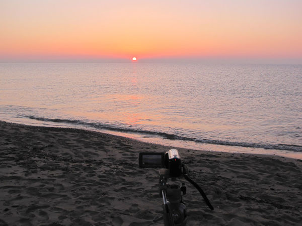 Beach Beach Photography Beauty In Nature Day Filming Sunrise Horizon Over Water Horizontal Nature Outdoors Person Scenics Sea Sky Sunset Tranquility Travel Destinations Tripod Photography Water