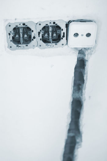 High angle view of telephone on snow