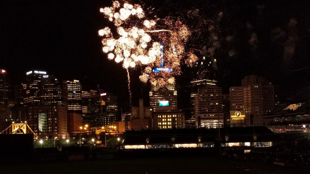 Night Illuminated Celebration Skyscraper Firework Display Building Exterior Outdoors Arts Culture And Entertainment City Firework - Man Made Object Architecture Urban Skyline Cityscape Sky Excitement Spectator Baseball Stadium Pittsburgh Pirates PNC Park Pittsburgh Pennsylvania Large Group Of People Motion Awe Exploding
