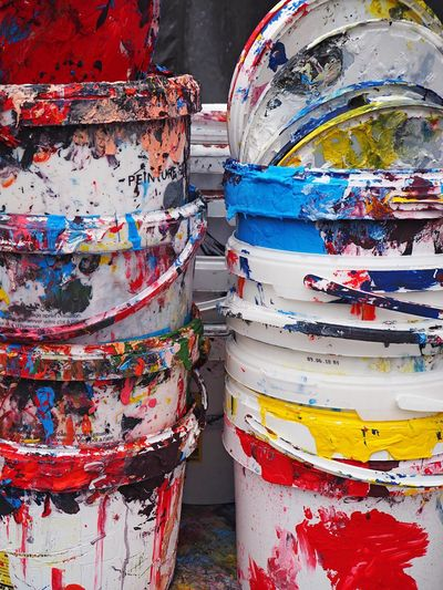 Close-Up Of Empty Colorful Paint Buckets