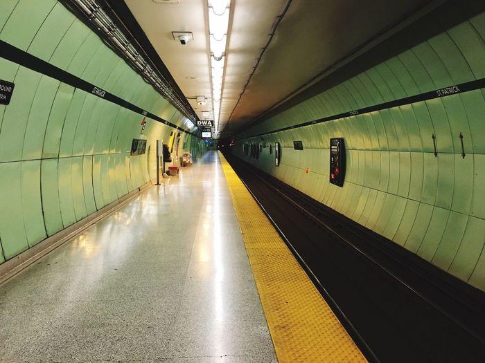 Empty platform at illuminated subway station