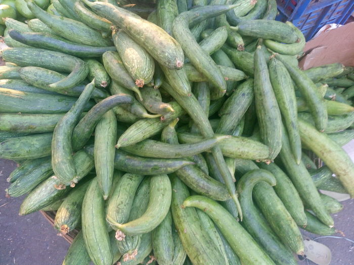 High Angle View Of Sponge Gourds On Wicker Basket For Sale At Street Market