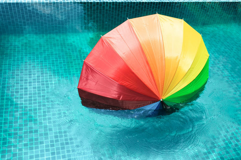 High angle view of multi colored umbrella on swimming pool