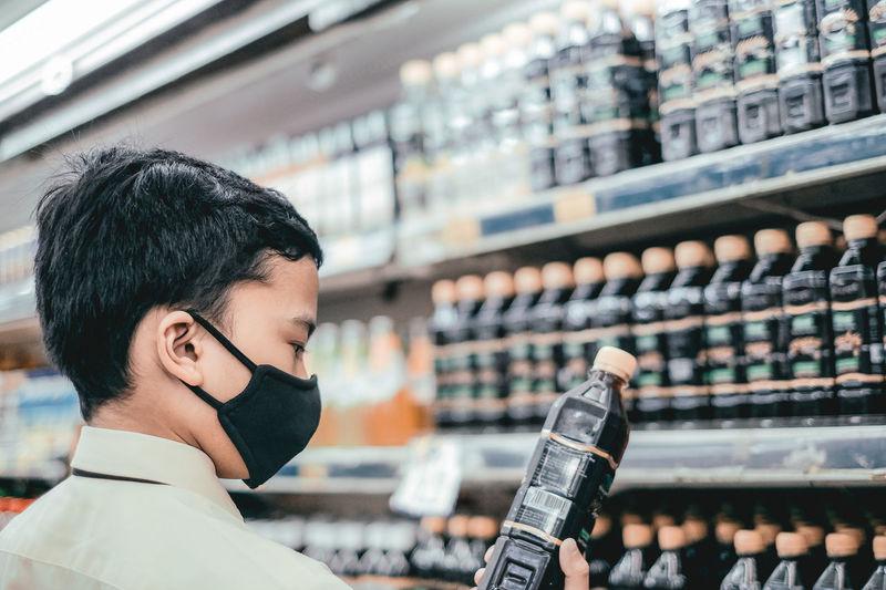 Portrait of man holding beer bottle