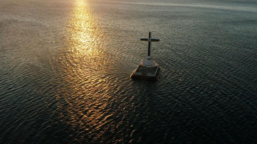High angle view of cross on sea