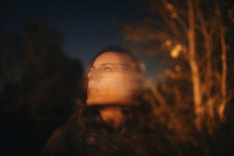 Portrait of teenage girl looking away outdoors