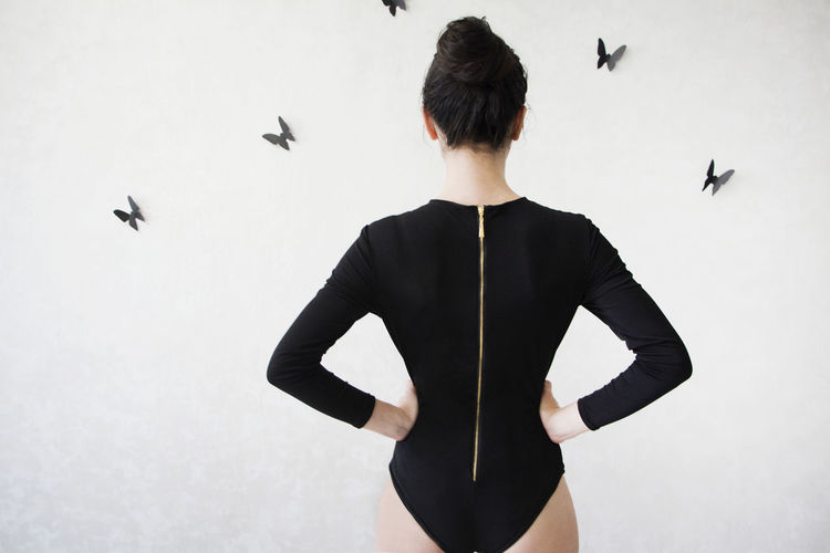 Baby Back View Back View Of Girl Bodysuit Confidence  Fashion Girl Model One Person Person Person's Back Standing Style Waist Up Wall With Butterfl White Wall Working