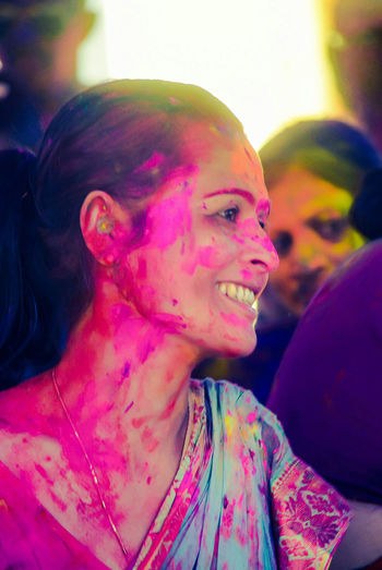 Arts Culture And Entertainment Looking At Camera Beautiful People Beautiful Woman Long Hair Only Women One Young Woman Only Portrait Women People Orange Color Outdoors One Woman Only One Person Young Women Beauty Colour Colours Multi Colors Holi Face Paint