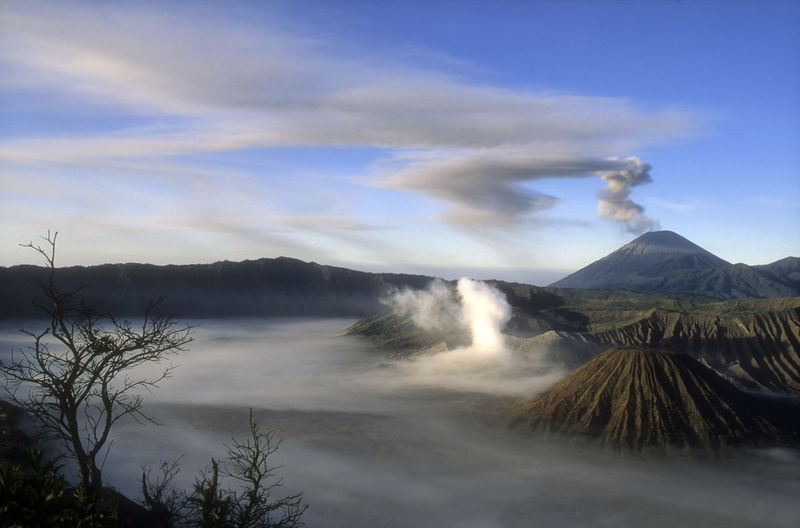 Eruption at Volcano Bromo - Indonesia Calder INDONESIA Java Smoke Beauty In Nature Blue Sky Bromo Bromo Tengger Semeru National Park Cloud - Sky Day Eruption Landscape Mountain Mountain Range Nature No People Outdoors Physical Geography Power In Nature Scenics Sky Tranquil Scene Tranquility Travel Destinations Volcano
