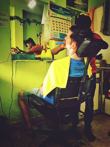 Wet Shave in Sri Lanka Sitting Chair Indoors  Full Length Real People People Adult Day Haircut Hair Wet Shave Razor hairdresser Hairdresser Barbershop