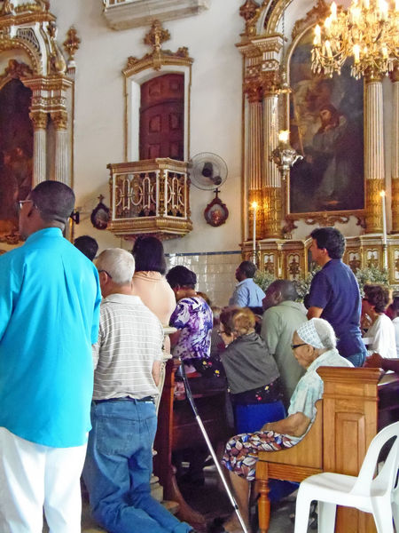 Packed congregation on a holy feast day - Cathedral of Salvador, Brazil Cathedral Of Salvador Congregation Place Of Worship Salvador Bahia Salvador Brasil Worshippers Architecture Built Structure Day Indoors  Large Group Of People Lifestyles Men People Place Of Worship Real People Rear View Religion Sitting Spirituality Standing Women Blind Guidestick