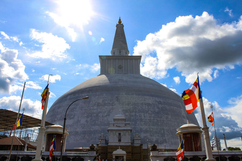 Architecture Built Structure Cloud - Sky Day Flag No People Outdoors Patriotism Place Of Worship Religion Ruwanwelisaya Sky Spirituality Sri Lanka Stupa Temple Architecture