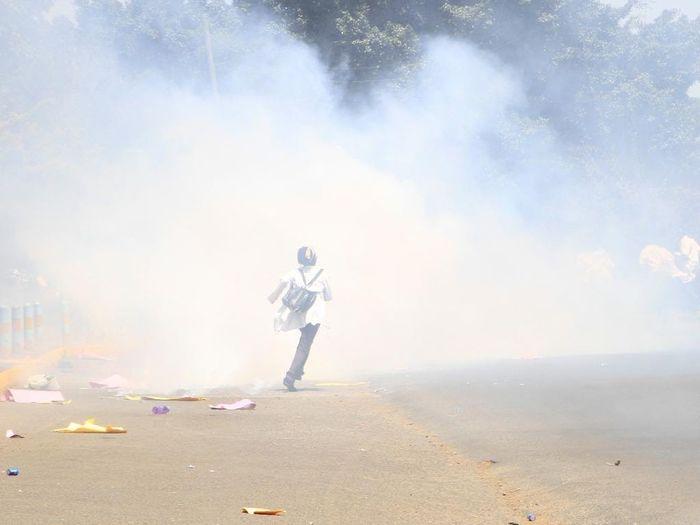 Lone Demonstrator Amidst Tear Gas