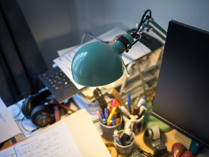 Close-Up Of Messy Desk Of Student