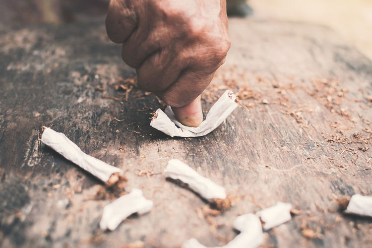 Cropped Image Of Hand Crushing Cigarette