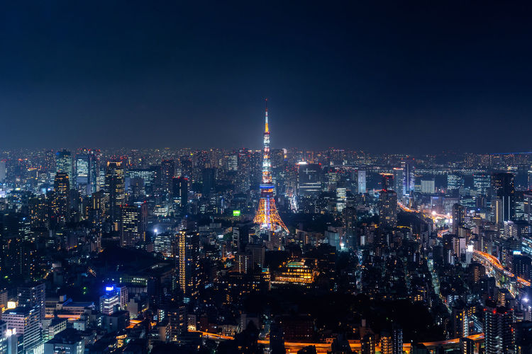 Tokyo cityscape at night, Japan. Architecture Building Building Exterior Built Structure City City Life Cityscape Crowd Crowded Financial District  Illuminated Landscape Modern Night Office Building Exterior Outdoors Sky Skyscraper Tower Travel Destinations Urban Skyline