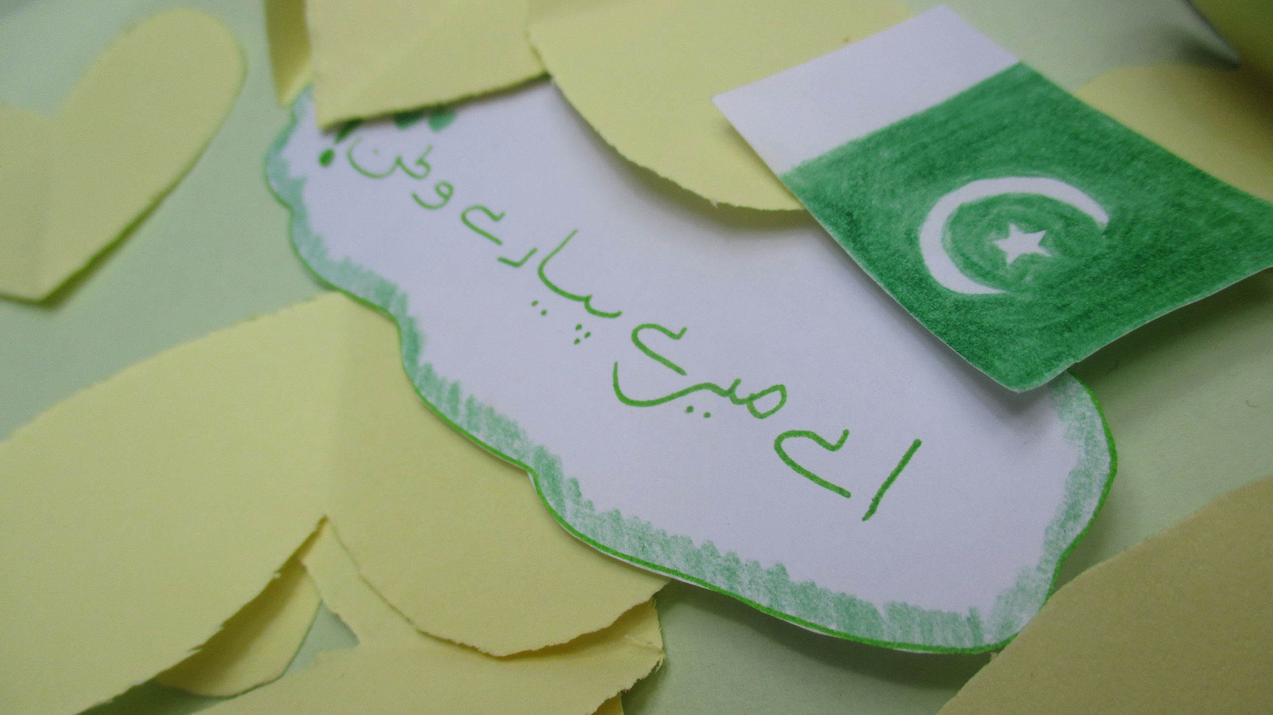 indoors, high angle view, close-up, text, paper, green color, message, full frame, geometric shape, no people, multi colored
