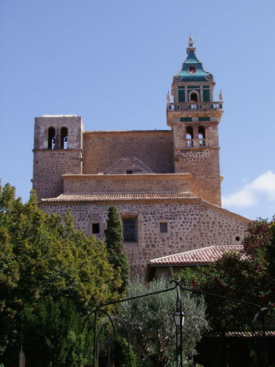 Bell Tower & Tower, Valldemossa Monastery Composition Mallorca Monastery Place Of Worship SPAIN Spirituality Trees Two Towers Valldemossa View From The Garden Architecture Bell Tower Blue Sky Building Exterior Built Structure History Low Angle View No People Outdoor Photography Place Of Prayer Religion Stone Walls Tiled Roof  Tower Travel Destination