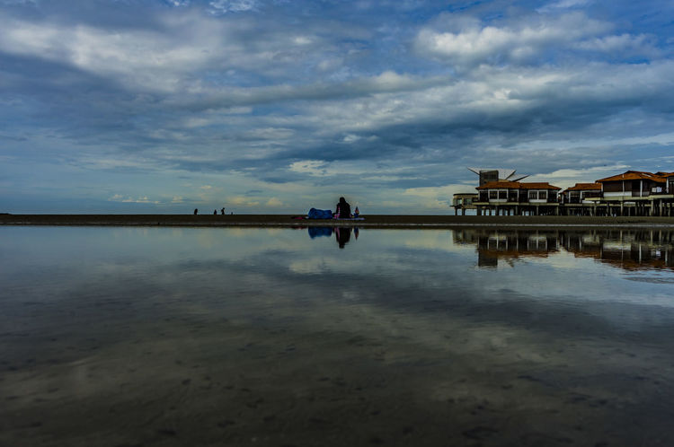 Water Ocean Reflection Malaysia Port Dickson Reflection Cloud - Sky Water Outdoors Architecture Sky One Person Nature Lake People Built Structure Building Exterior Adult Fisherman Rural Scene Landscape Day Horizon Over Water City Low Tide