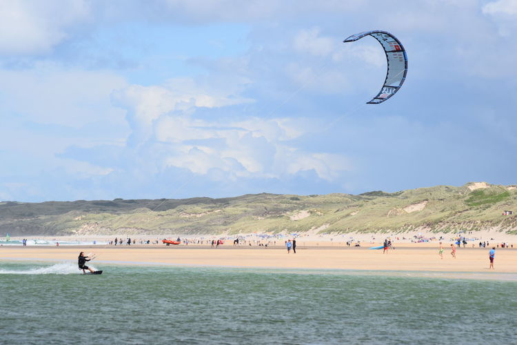 kite surfing Hanging Out Holidays RISK Skill  Sky And Clouds Beachphotography Cornwall Uk Kite Surfing People Porthkidney Beach Summer Water Sports Mix Yourself A Good Time