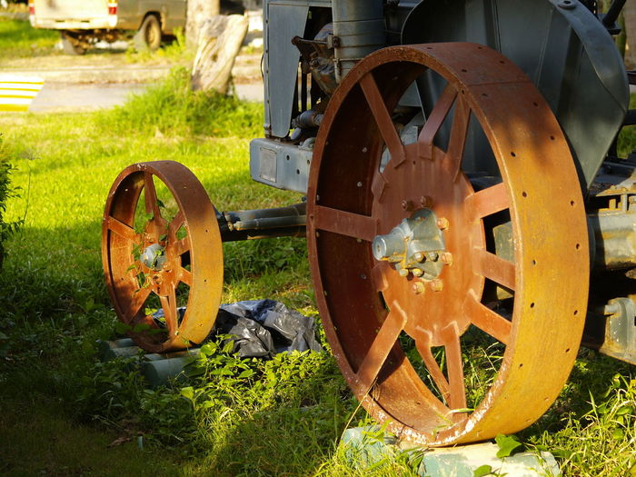 Close-up of vintage wheel on field