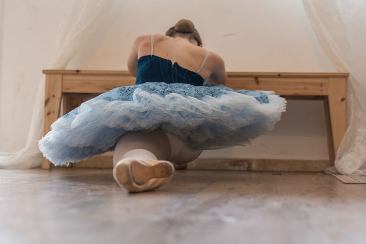 Baby girl on hardwood floor