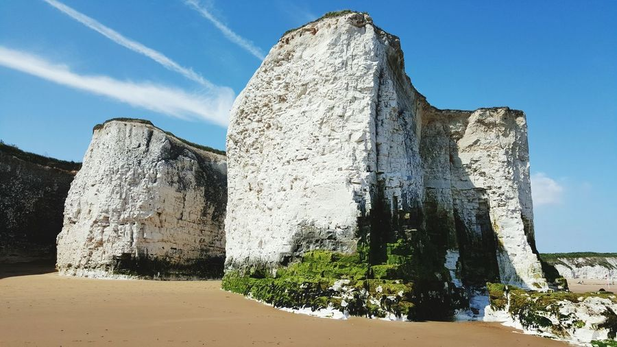 Low angle view of rock formation on beach