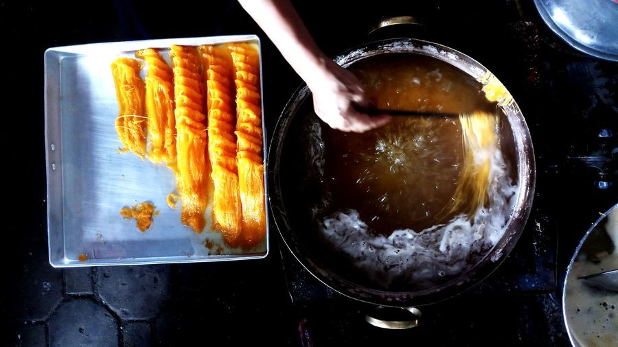 Person preparing food in kitchen