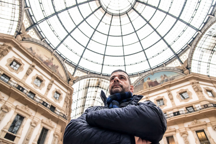 Low Angle View Of Man In Galleria Vittorio Emanuele Ii