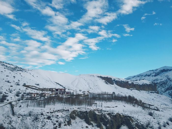 Isolated yet inhabited. Beauty In Nature VSCO Photooftheday Photo Photography Blue Sky EyeEmNewHere Landscape_photography Landscape Village Mountain Sky Scenics Nature Cold Temperature Tranquil Scene Beauty In Nature Snow Tranquility Winter No People Blue Frozen Mountain Range Weather Outdoors