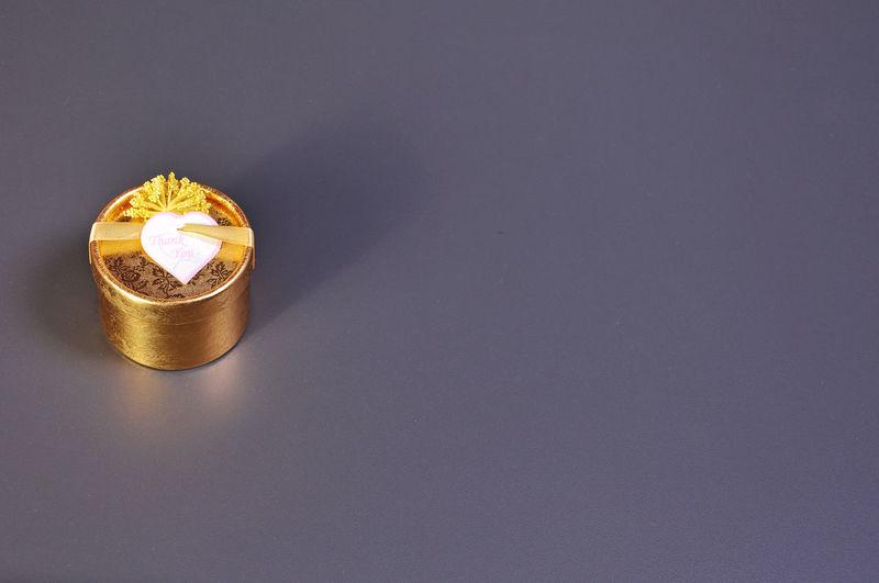 Golden gift box on gray background