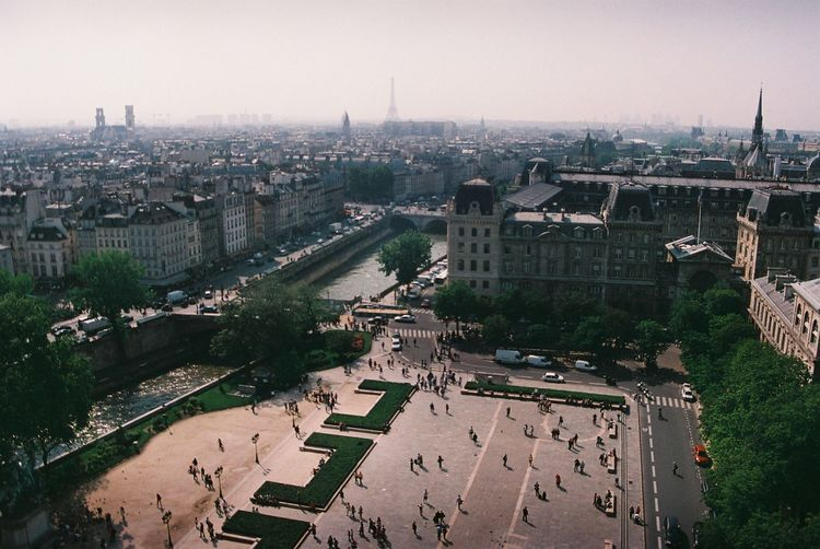 A Bird's Eye View Analogue Photography Architecture Building Exterior Built Structure City City Life Cityscape Film Film Photography High Angle View Horizon Large Group Of People Paris Paris, France  Residential District Rooftop Sky Square Tour Eiffel Tourism Tourist Attraction  Tower Town Square Travel Destinations