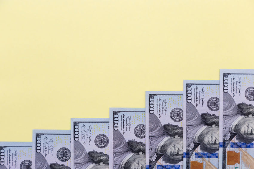 american dollars on a color background - banknotes of hundred dollar bills Nobody Ladder Stairs Mockup Mock Up American Budget Business Copy Space Currency Economy Jackpot USD Assets Background Cash Colorful Copy Space Credit Dollar Dollars Finance Financial Money No People Retirement Savings Tax Yellow Yellow Background
