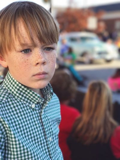 EyeEm Selects Parade Time!! Cute Boy Focused Thoughts Perplexed Boy Boy With Freckles Freckles Christmas Parade Watching Parade Parade Blurred Background People Day Close-up Indoors  Portrait One Person Lifestyles Elementary Age Headshot Child Real People Childhood Boys EyeEm Selects