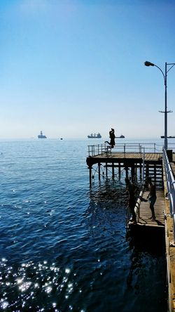 Lastsummerdays Sunnyday Sea And Sky Seascape Seaview Gottheshot JumpingSea Water Pier Jetty Horizon Over Water Men Clear Sky Tranquil Scene Silhouette Person Outdoors Beauty In Nature Blue Relaxation Life Is A Beach Seaandsun People Photography Tranquility