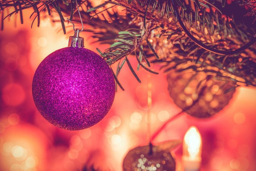 Purple Christmas bauble hanging on a tree Glitter Classic Purple Bauble Decoration Ornament Christmas Christmas Decoration Hanging Celebration Christmas Ornament christmas tree Illuminated Close-up Night No People Christmas Lights Bauble Indoors