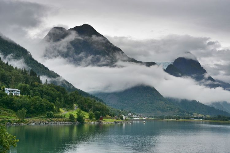 EyEmNewHere Misty Norway Beauty In Nature Cloud - Sky Day Fjord Landscape Mountain Mountain Peak Mountain Range Nature No People Non-urban Scene Outdoors Reflection Scenics - Nature Sky Tranquil Scene Tranquility Tree Water Waterfront EyeEmNewHere