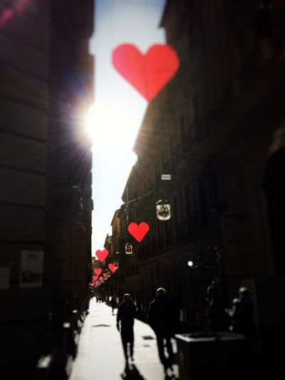 Celebrate Love Couple Love Heart Valentine's Day  Architecture Built Structure City Building Exterior Street Real People Lens Flare Sunlight Heart Shape Red Illuminated Love Is Love
