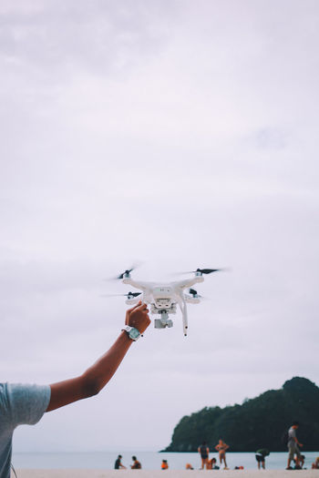 Adult Adults Only Airplane Animal Themes Bird Close-up Cloud - Sky Day Drone  Drone  Droneshot Flying Focus On Foreground Holding Holding Hands Human Body Part Human Hand Leisure Activity One Person Only Women Outdoors People Real People Sky Temptation