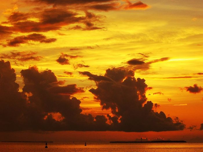 Scenic view of sea against orange cloudy sky