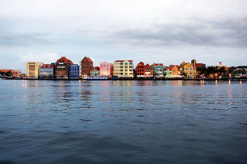 Handelskade Schottegat UNESCO World Heritage Site Building Building Exterior Built Structure City Cloud - Sky No People Outdoors Reflection Residential District Rippled Water Waterfront