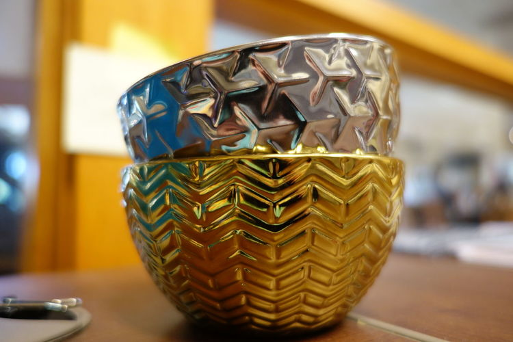 Metlaic bowls of holding on a desk Bowl Bowls Close-up Focus On Foreground Geometric Metalic Metalized, Burnished; Shiny, Glossy, Lustrous No People Shiny Silver  Yellow Zig-zag Zig-zag Design Zigzag