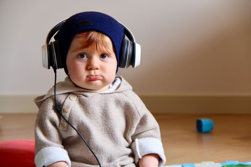 Cildren Music Singstar Creative Photography EyeEm Selects Sings Dance SIMPLY Headphones On  EyeEm Selects Childhood Child Indoors  Portrait Front View Innocence One Person Men Boys Listening Sitting Headphones Music Males  Real People Looking At Camera Clothing Cute