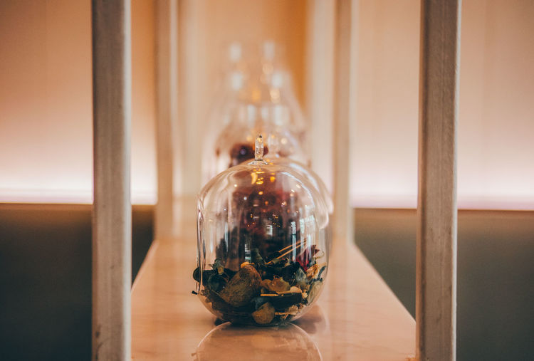 Close-up of glass jar on table
