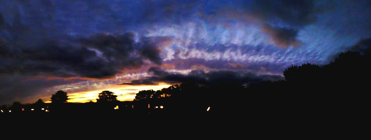 Silhouette Sunset Tree Tranquil Scene Tranquility Scenics Dark Dramatic Sky Sky Beauty In Nature Nature Growth Calm Cloud - Sky Storm Cloud Blue Outdoors Majestic Non-urban Scene Moody Sky Eyeemphotography Sunset_collection Panoramic Photography Panorama Sunset Michigan
