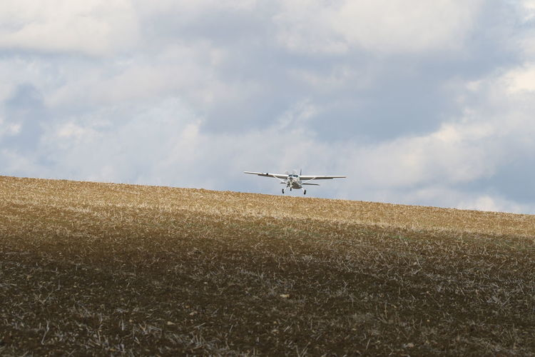 Air Vehicle Airplane Cloud - Sky Day Flying Low Flying Nature Open Field Outdoors Sky Transportation