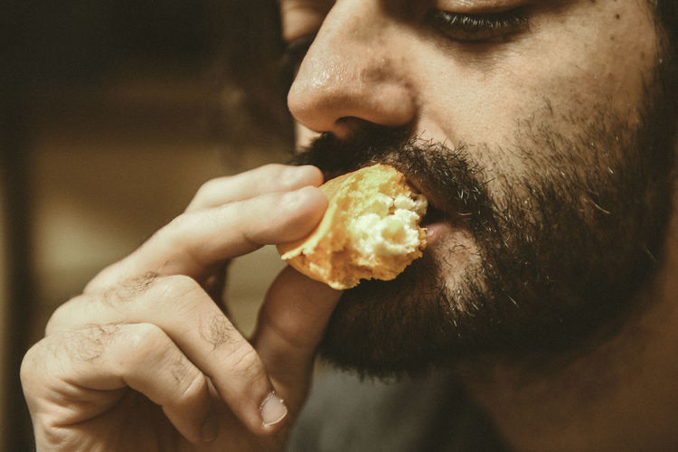 Close-Up Of Man Eating Cake