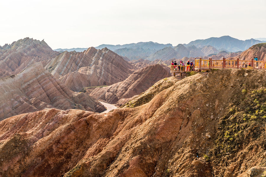 People viewing the sights at the Zhangye Danxia Landform, Gansu, China Arid Climate China Colour Day Desert Gansu Geological Formation Landscape Mountain Natural Beauty Nature Orange Color Outdoors Pattern People Physical Geography Red Remote Rock Formation Travel Travel Destinations Travelling Zhangyedanxialandform High Resolution