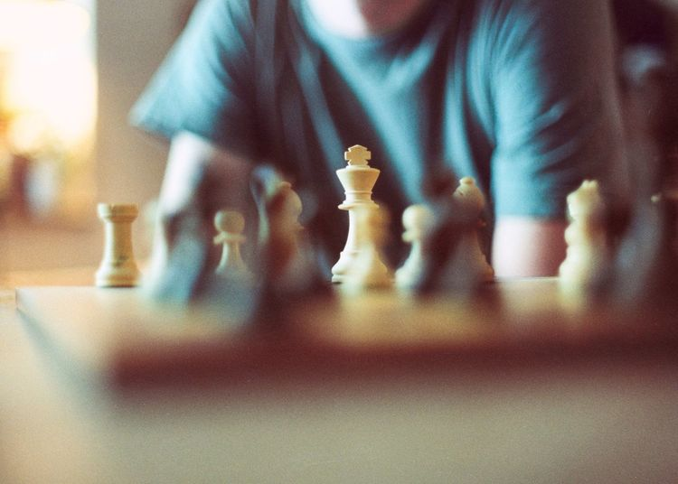 Low angle view of man playing on chess